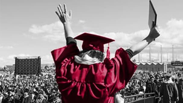 Graduate on stage celebrating