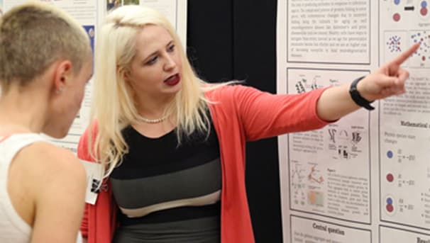 Female student presenting at SOURCE