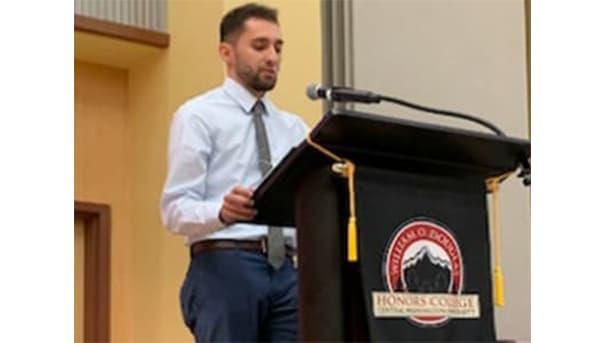 Honors student at podium