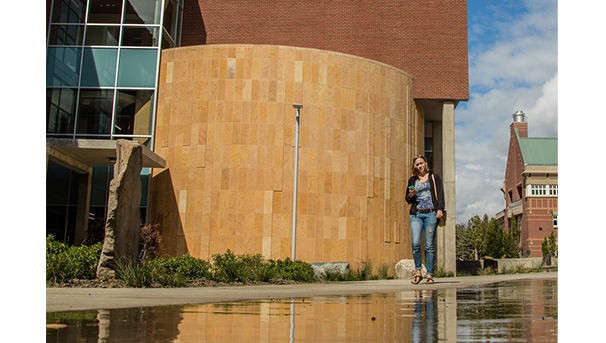 student walking on campus near Science I building