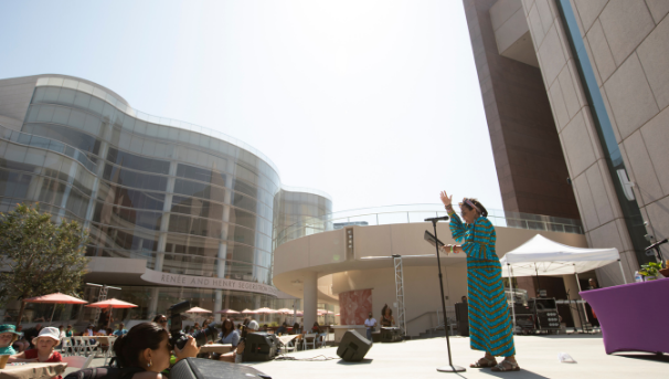 Woman speaking from an outdoor stage