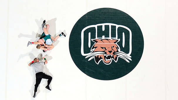photo of wrestlers and ref on OHIO mat