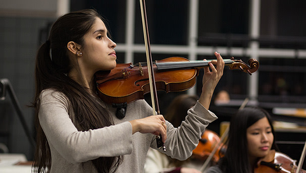 photo of students in a symphony orchestra rehearsal session, spring 2020 in Glidden Hall