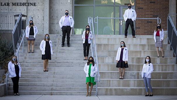 Med students in masks on steps of UNR Med building