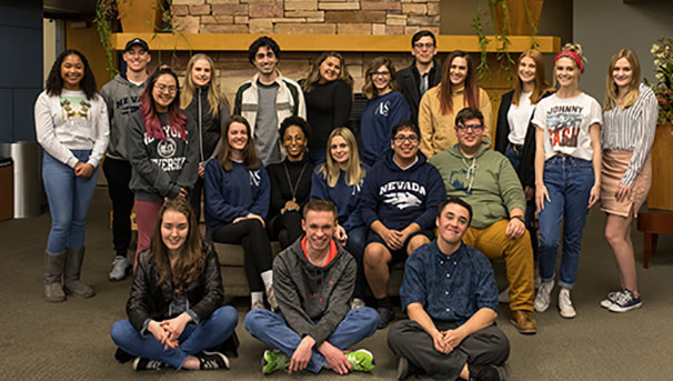 Students in Front of Fireplace