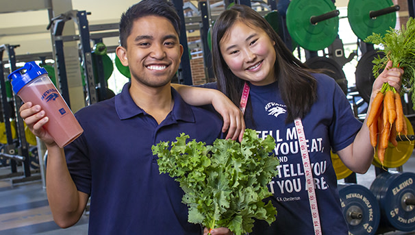 Students in gym with healthy food