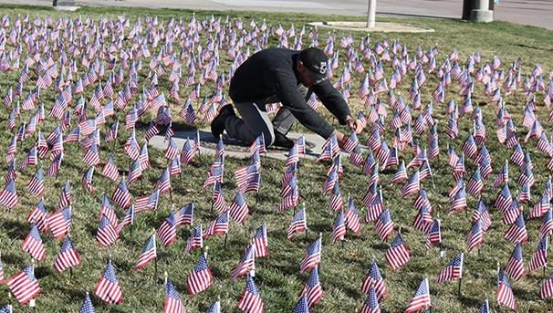 Veteran student planting flags