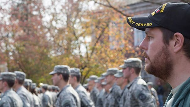 Army ROTC cadets and others stand during College Green event
