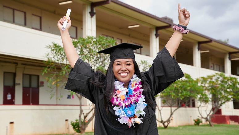 Nest Steps High School Graduate holding diploma