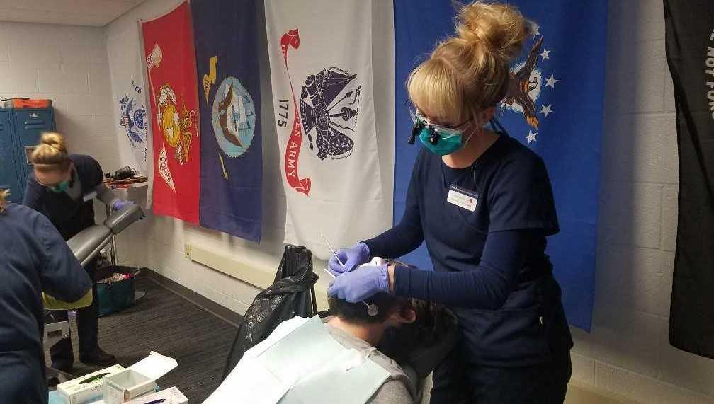 A student providing denatal care