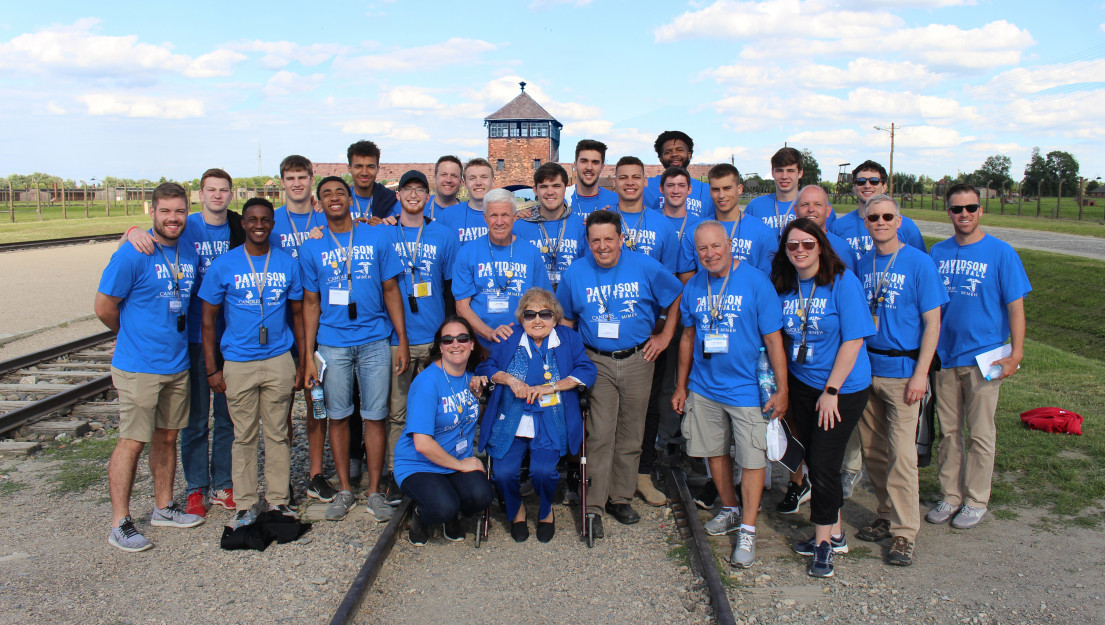 Eva Mozes Kor (center) leads the annual CANDLES educational trip to Auschwitz