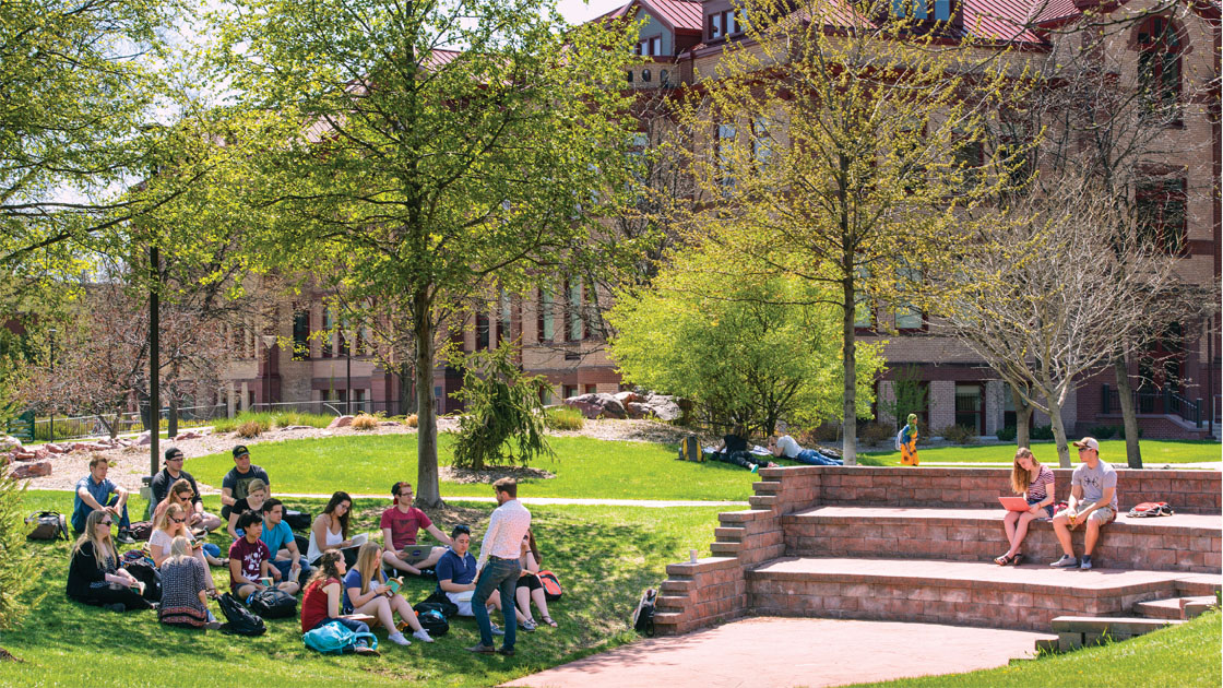 Students sitting outside studying