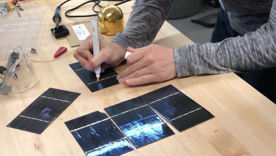 Trevor Wise '23 Soldering Solar Panels.