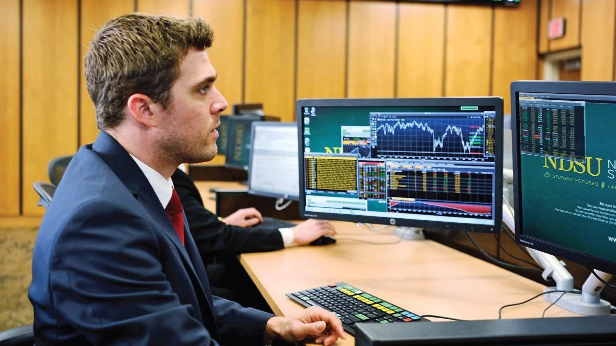 student watching stocks