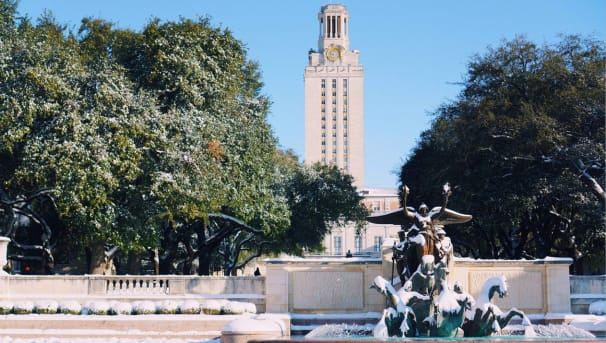 The University of Texas at Austin Tower and Littlefield Fountain covered in snow and ice
