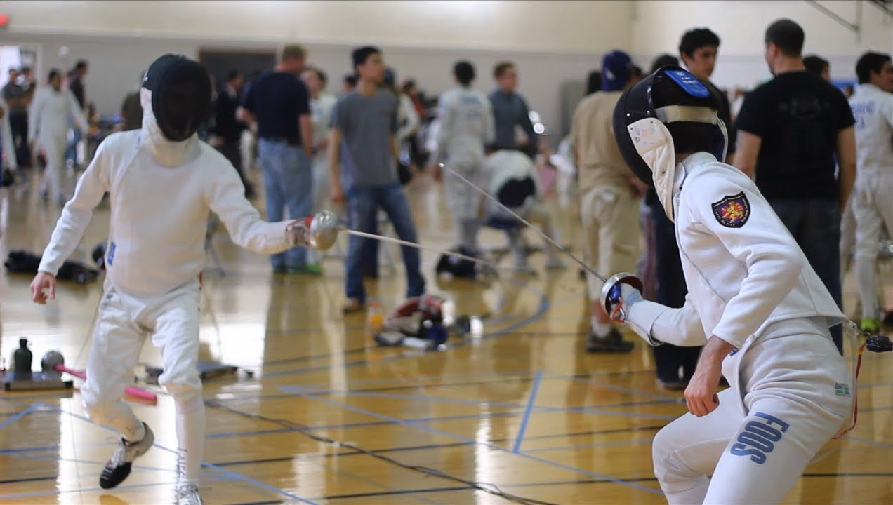 Two epee fencers fencing during an Okawa Open held in 2014