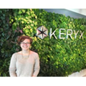 Sarah Manlove pictured in front of a wall with KERYX on it.