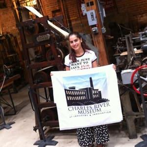 Cinzia Presti holding a print Charles River Museum