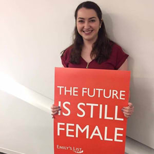 Ellie Pasternack holding a sign saying The Future is Still Female