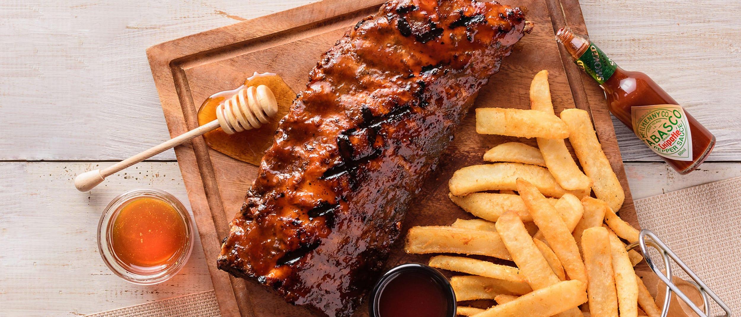 TGI Fridays: New smokey chipotle honey ribs rack $32*