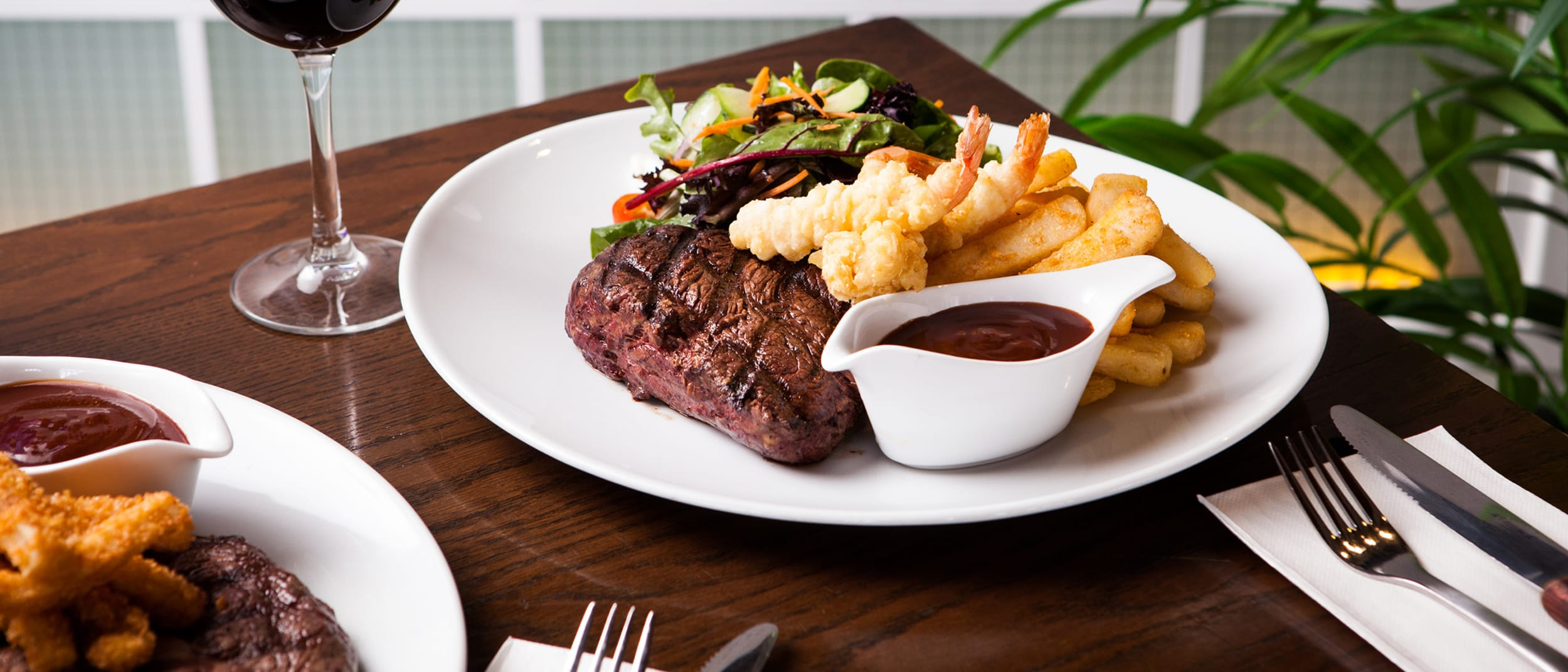 Beach House Bar & Grill: buy one, get one free steak on Monday