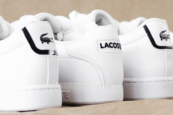 Shop Lacoste's latest collection at JD Sports