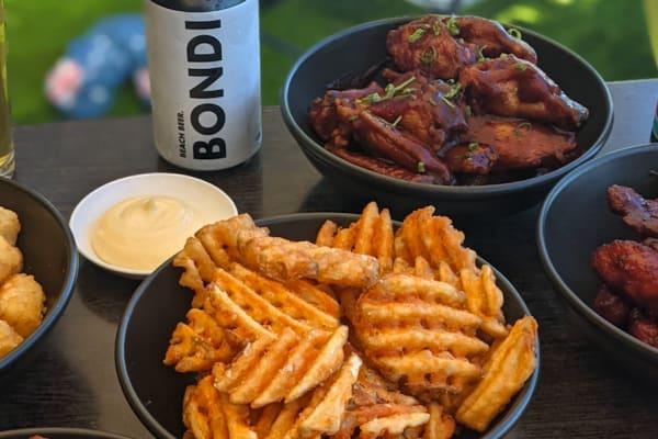 Bondi Pizza: Bondi beer & new wings menu