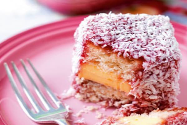 Taste delicious strawberry Jam and custard lamingtons