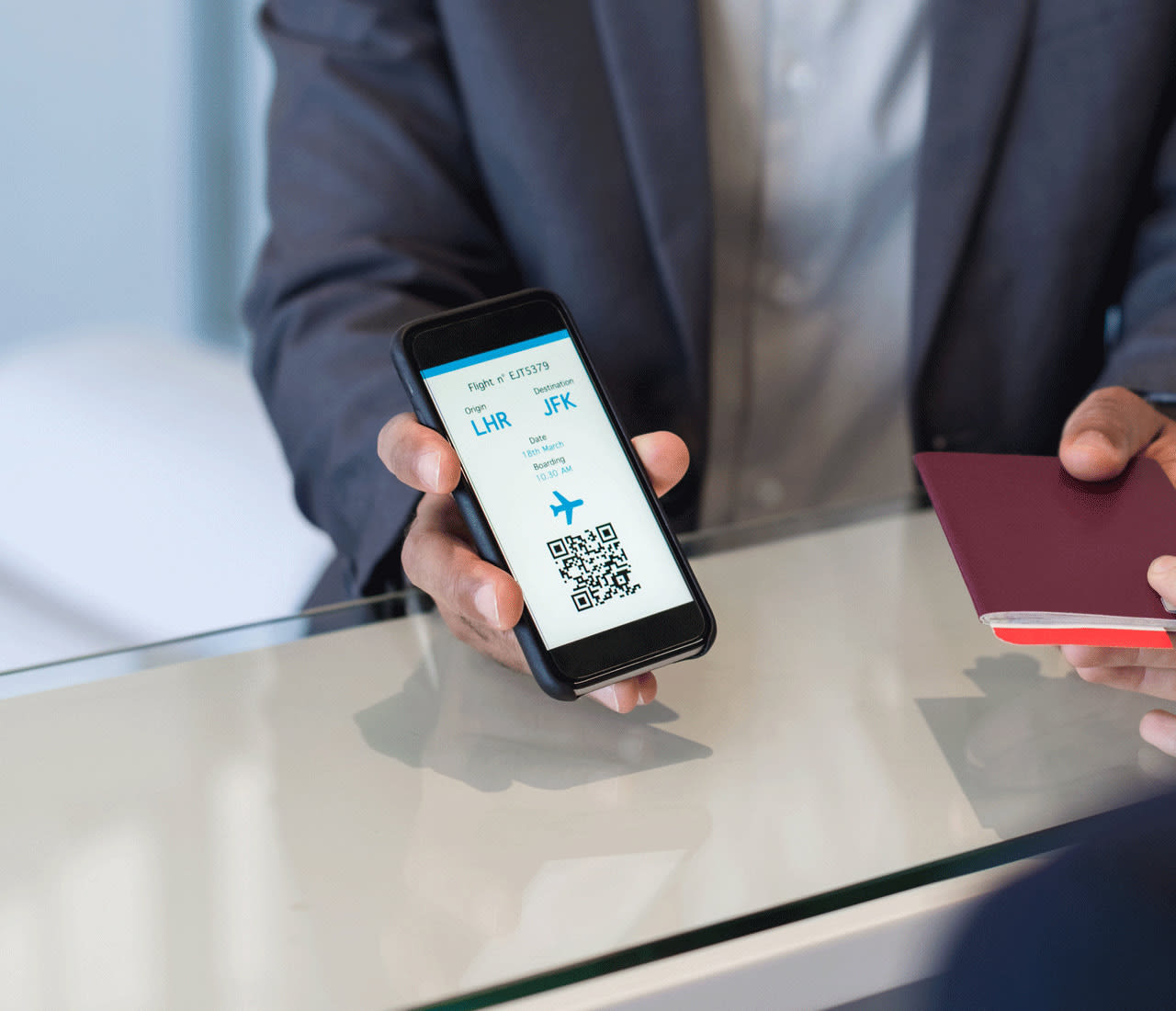 Scanning boarding pass to access flight updates, gate assignment, upgrades and vouchers
