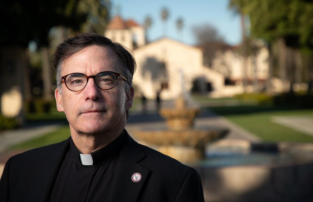 Fr. Kevin O'Brien stands in front of the Mission Santa Clara