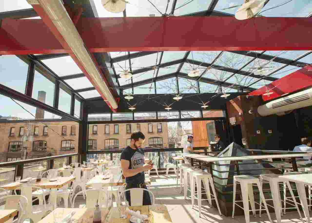 Retractable roof helps this restaurant push the boundaries of patio season