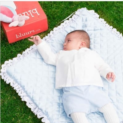 Baby reaching for bluum box