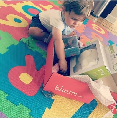 Child playing with bluum box