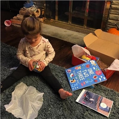 Toddler playing with Bluum box