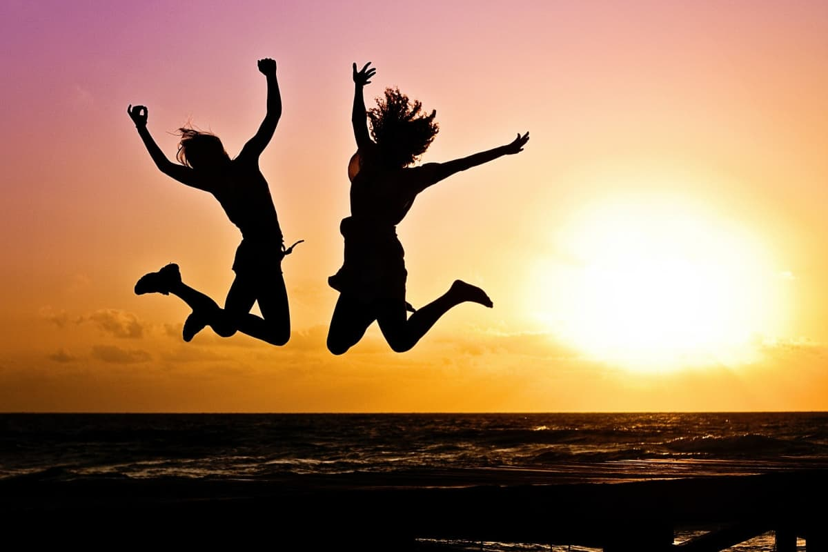 girls jumping in the sunset