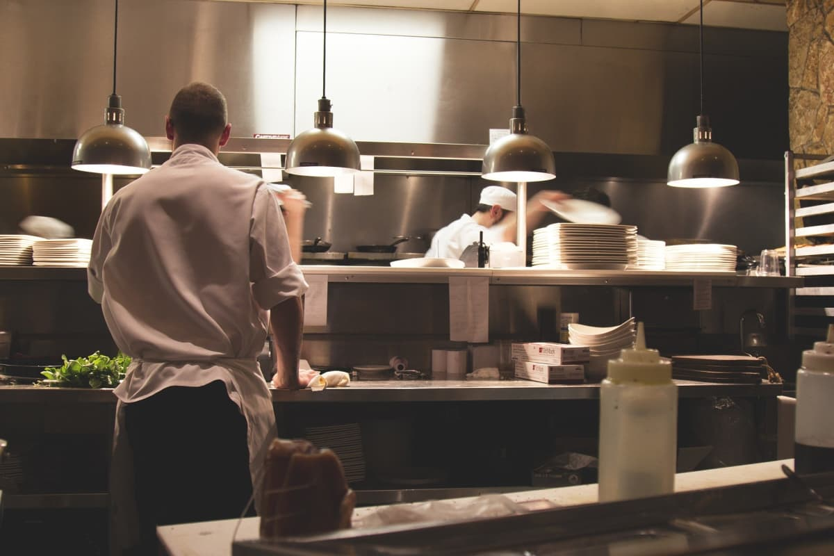 chefs in professional kitchen