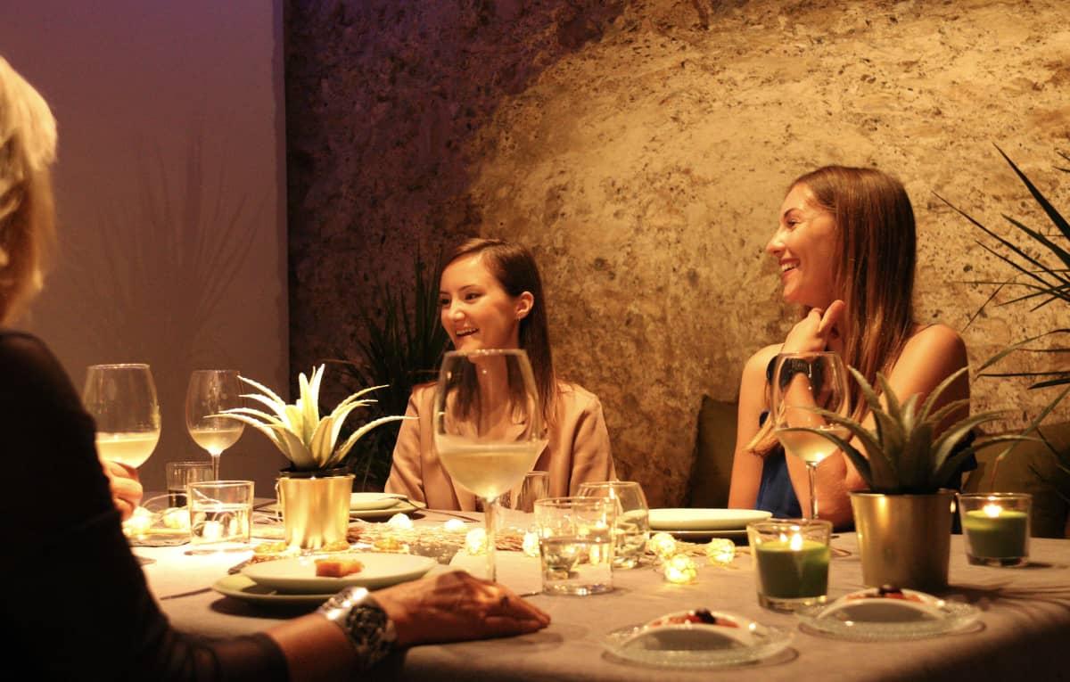 women eating in unique venue