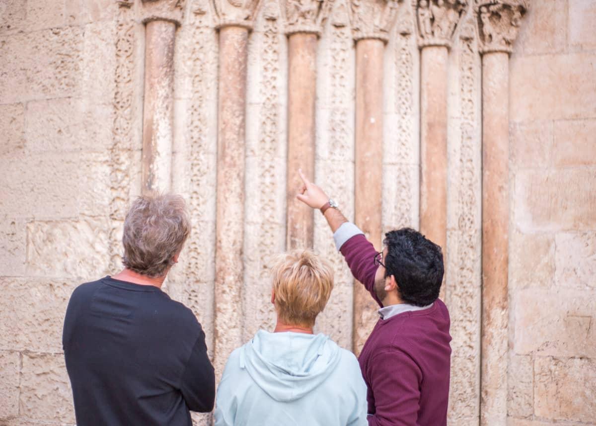 tour guide explaining architecture