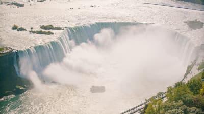 Maid of the mist under the falls Niagara Falls