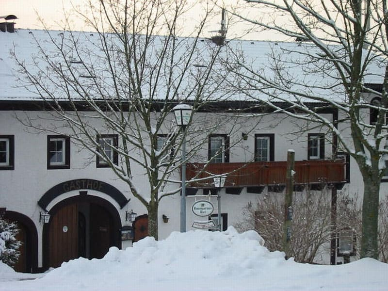 Farmhouse covered in snow