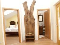 Eingangsbereich mit Schlaf- und Badezimmer im Blumenstoeckel