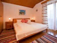 Schlafzimmer im Ferienhaus am Waldrand