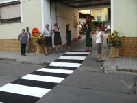 At the zebra crossing near the open cellar door
