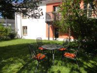 Garten mit Eingang zum Apartment
