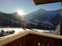 Blick auf den Schmittenstein bei Sonnenaufgang vom Appartement aus