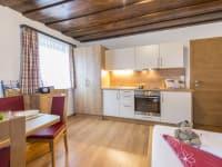 Biohof Maurachgut - Appartement Schlossalmblick - Wohnraum mit Küche