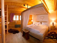 Romantikzimmer mit Himmelbett