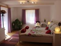 Romantikzimmer mit direktem Zugang zur Sonnenterrasse