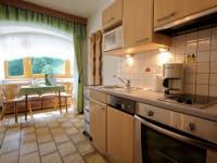 Appartement Almrose Küche und Essbereich