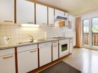 Wohnküche mit Balkon